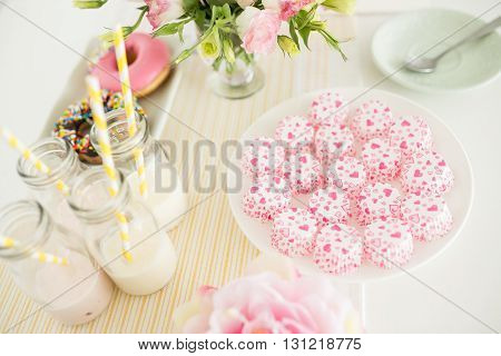 Candies and drinks on table, selective focus