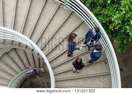 Top view of business people at staircase