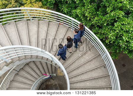 Top view of business people walking up the stair