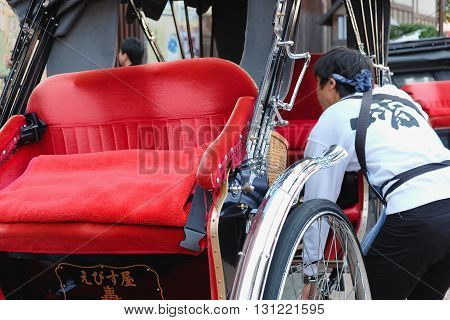 TOKYO, JAPAN - MARCH 29 2016 :rickshaw waiting area near the around Senso-ji Temple in Asakusa on March 29 2016. The Rickshaws are a popular way to tour the city.