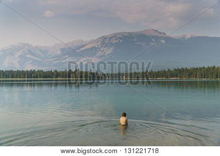 Child in Cold Glacier Water in Lake near Jasper Alberta