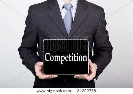 technology, internet and networking in business concept - businessman holding a tablet pc with competition sign. Internet technologies in business.