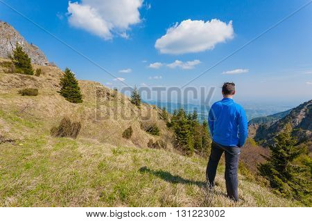 Man On Top Of Mountain