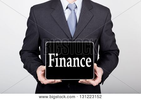 technology, internet and networking in business concept - businessman holding a tablet pc with finance sign. Internet technologies in business.