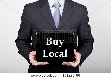 technology, internet and networking in business concept - businessman holding a tablet pc with buy local sign. Internet technologies in business.