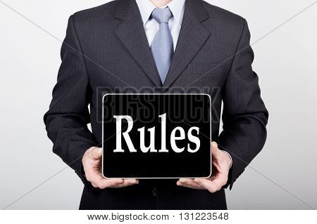 technology, internet and networking in business concept - businessman holding a tablet pc with rules sign. Internet technologies in business.