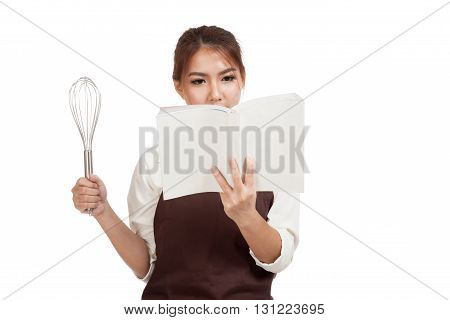 Asian Baker Girl With Whisk And Cook Book