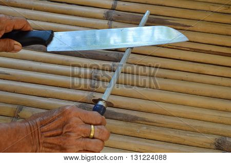knife and curved steel on bamboo background