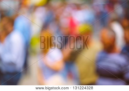 Abstract blur crowd of people on the street unrecognizable everyday ordinary men and women as blur urban background.