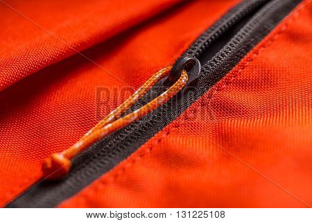 Zippered red bag pocket close up shot
