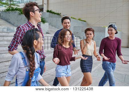 Group of friends walking in the street together