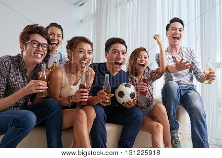 Vietnamese young people cheering for their favorite soccer team