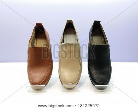 leather shoes put on shelter as background