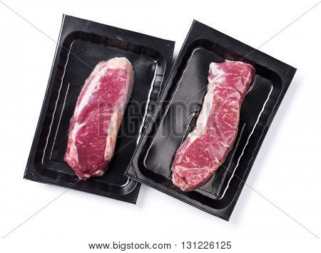 Raw striploin steak. Isolated on white background