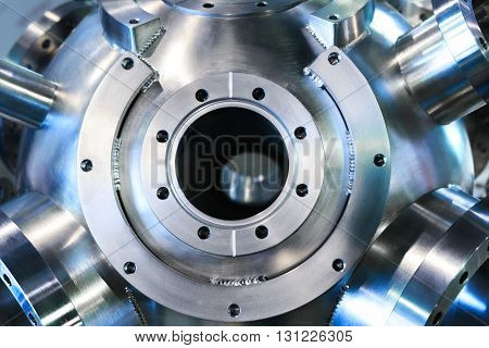 Industrial background, heavy metal housing with welded metal flanges.