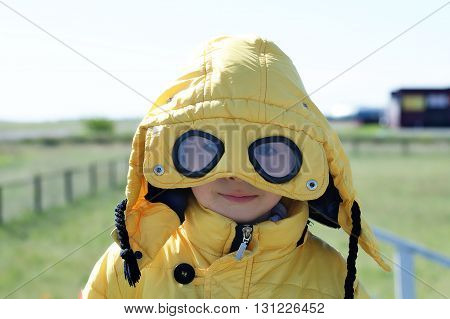 Boy In Yellow  Coat With Glasses Outside