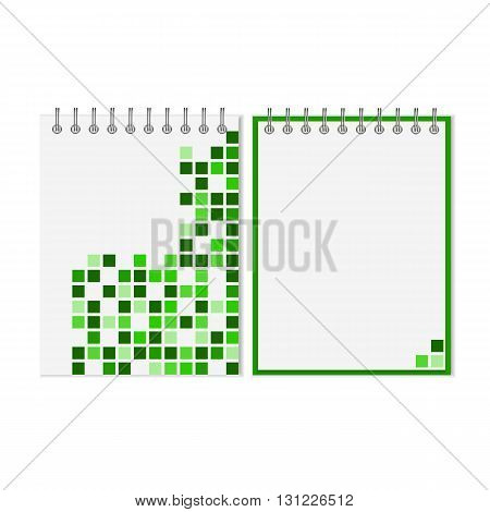 Spiral notebook with green geometric pattern on cover