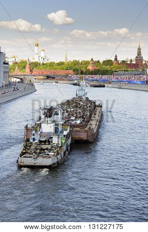 MOSCOW, RUSSIA - MAY 07, 2016: Transportation of scrap metal on a barge on Moscow River.