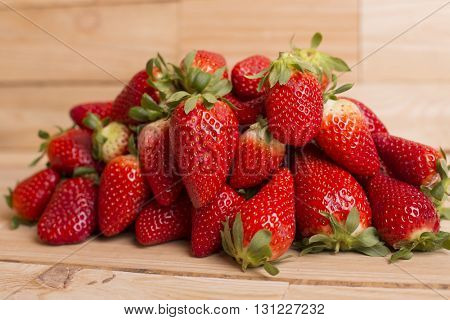 strawberries on a wooden table, studio picture