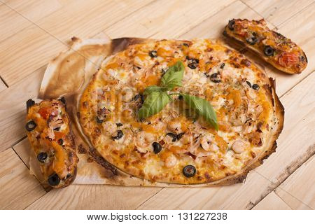 home made hot pizza on wooden table