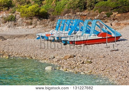 Multicolored Catamarans On The Beach
