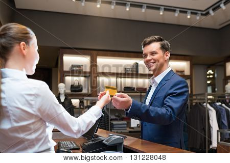 Smiling businessman at counter