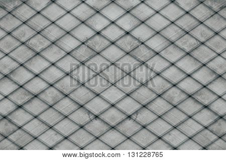 Abstract grey background of the wooden planks. Plaid background. Abstract minimalistic pattern of lozenges. Gray background.