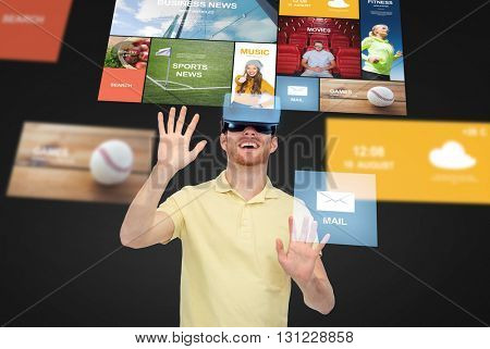 3d technology, virtual reality, entertainment, media and people concept - happy young man in virtual reality headset or 3d glasses playing game over black background with internet applications