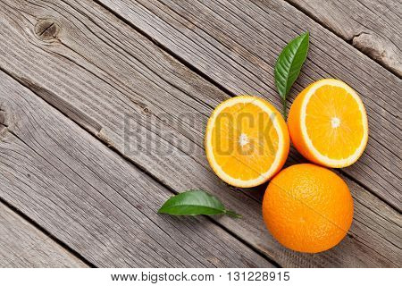 Fresh ripe oranges on wooden table. Top view with copy space