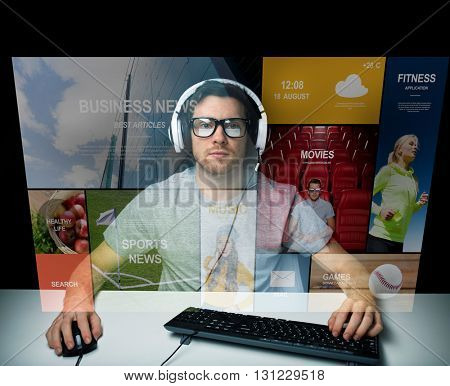 technology, communication, mass media, virtual reality and people concept - young man in headset and eyeglasses with pc computer keyboard over virtual screen