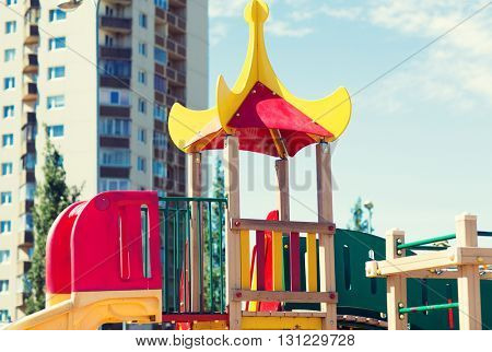 summer, childhood, leisure and people concept - close up of climbing frame at city children playground