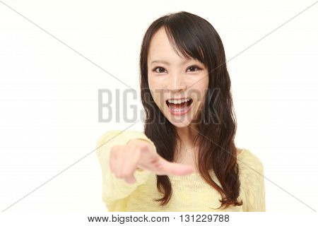 portrait of young Japanese woman witnessed something on white background
