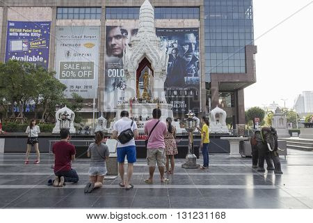 BANGKOK THAILAND - APR 17 : Unidentified tourist pray to Trimurati shrine at Central world in Ratchaprasong area on april 17 2016. Thailand. Trimurati shrine is one of sacred item in Ratchaprasong area