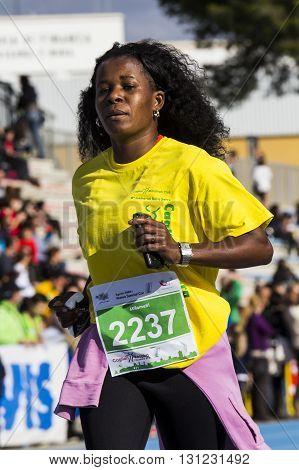 CAGLIARI, ITALY - December 7, 2014: 7 ^ Half Marathon - Memorial Delio Serra - Athlete at the end of the race for the arrival