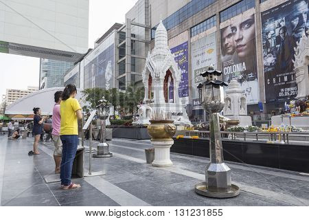 BANGKOK THAILAND - APR 17 : scene of worship in Ganesha shrine at Central world in Ratchaprasong area on april 17 2016. Thailand. Ganesha shrine is one of sacred item in Ratchaprasong area