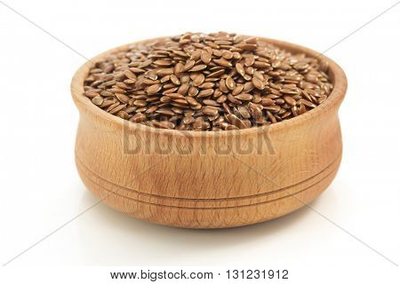 flax seeds in bowl isolated on white background