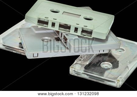 Audio cassette and tape on black background