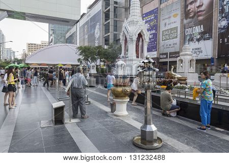 BANGKOK THAILAND - APR 17 : Unidentified people in Ganesha shrine and Trimurati shrine at Central world in Ratchaprasong area on april 17 2016. Thailand. thare are many shrine gods in Ratchaprasong area