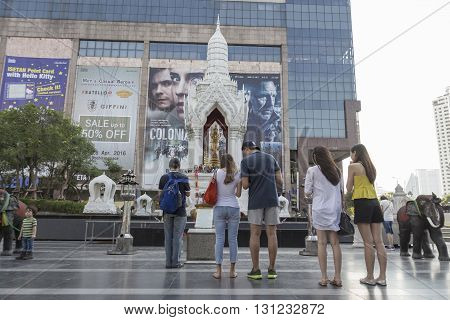BANGKOK THAILAND - APR 17 : scene of tourist worship in Trimurati shrine at Central world in Ratchaprasong area on april 17 2016. Thailand. Trimurati shrine is one of sacred item in Ratchaprasong area