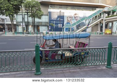 BANGKOK THAILAND - APR 17 : tuktuk is parking in front of CentralWorld on Ratchaprasong road on april 17 2016 thailand. tuktuk is popular taxi service of tourists in bangkok