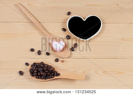 strong roasted coffee beans on grunge wood background