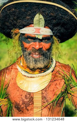 Man With Leaves In Papua New Guinea