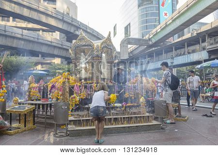 BANGKOK THAILAND - APR 17 : inside scene of people worship in Erawan shrine at Ratchaprasong Junction on april 17 2016 Thailand. Erawan shrine is one of famously sacred item in Ratchaprasong area