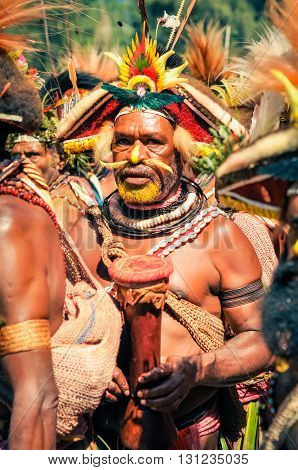 Half-naked Man With Drum In Papua New Guinea