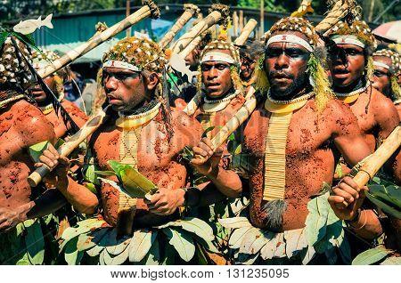 Walking Men In Papua New Guinea