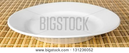 The symbolic white dishes on a bamboo litter.
