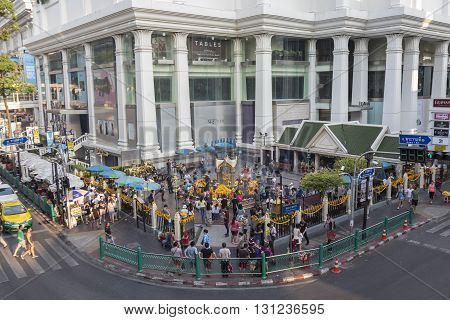 BANGKOK THAILAND - APR 17 : mass of thai people and foreigner worship in Erawan shrine at Ratchaprasong Junction on april 17 2016 Thailand. Erawan shrine is popular place in Ratchaprasong area