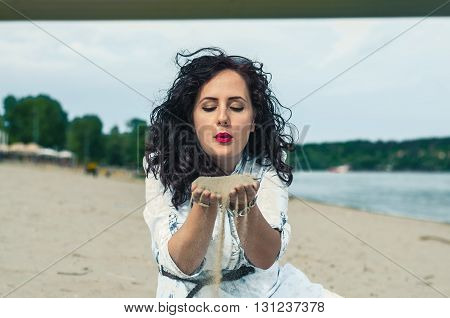 Pretty young woman enjoying her time on the beach.