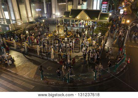 BANGKOK THAILAND - APR 17 : dusk scene of unidentified people worship in Erawan shrine at Ratchaprasong Junction on april 17 2016 Thailand.