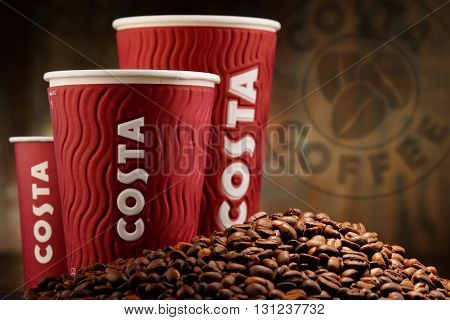 Composition With Cups Of Costa Coffee Coffee And Beans